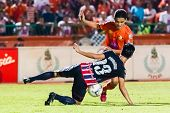 Sisaket Thailand-august 3: Sarayuth Chaikamdee Of Sisaket Fc. (orange) In Action During Thai Premier
