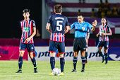 Sisaket Thailand-august 3: The Referee (blue) In Action During Thai Premier League