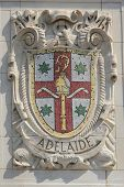 Mosaic shield of renowned port city Adelaide at the facade of United States Lines
