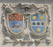Mosaic shields of renowned port cities Paris and Cherbourg  at the facade of United States Lines