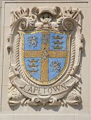 Mosaic shield of renowned port city Cape Town at the facade of United States Lines