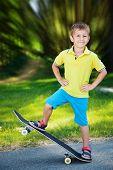 Little boy enjoying skateboarding in the park.