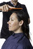Combing A Woman At The Hairdresser