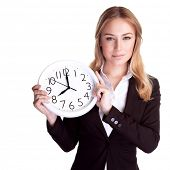Portrait of beautiful young business woman holding in hands clock, isolated on white background, dis