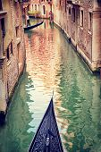 Venice, gondola floating on narrow Venetian street, famous transport in Venetian lagoon, travel and tourism concept