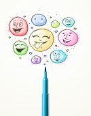 Coloured smiley face bubbles coming out of felt pen