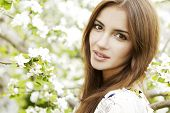 Portrait of young adult beautiful and attractive sensuality brunette woman in the garden