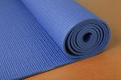 Blue yoga mat on orange