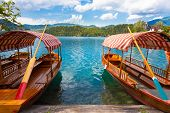 Traditional wooden boats on lake Bled, Slovenia.