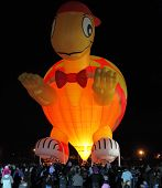 KIBBUTZ BEERY, ISRAEL - FEBRUARY 25, 2012: Huge balloon in the form of Teenage Mutant Ninja Turtles. Happening glowing balloons in the night sky