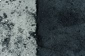Hot fresh and old asphalt layers on road surface