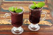 Acai Pulp In 2 Glass With Fresh Mint On Wooden Table