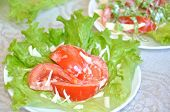 Tomatoes With Mayonnaise On Lettuce Leaf