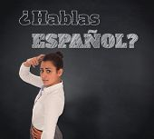 Composite image of worried businesswoman against blackboard, Do you speak Spanish?