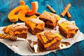 Pumpkin swirl brownies on blue wooden background