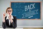 Thinking redhead businesswoman against blackboard with copy space on wooden board