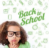 Back to school message with icons against cute pupil thinking