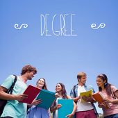 The word degree against students standing and chatting together