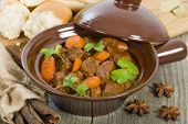 stock photo of stew  - Bo Kho - Vietnamese beef stew cooked with lemongrass, star anise, bay leaf and cassia bark served with crusty bread.