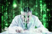 Mature businessman typing on keyboard against lines of green blurred letters falling
