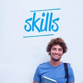 The word skills against happy student holding book