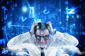 Stressed businessman touching his head against lines of blue blurred letters falling