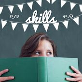 The word skills and bunting against student holding book