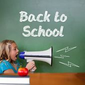 Back to school message against cute pupil shouting through megaphone