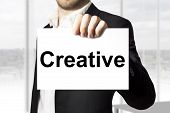 Businessman Holding Sign Creative