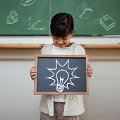 Idea and innovation graphic against cute pupil showing chalkboard