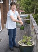 Senior Citizen Watering Her Plants