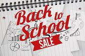 Back to school sale message against brainstorm doodles on notepad paper