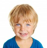 Happy little boy with tongue licking lips isolated on white background