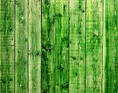 Texture - cracked paint of green color on a wooden surface