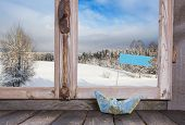 Winter Holiday Traveller Concept: Wooden Window Sill With Sail Boat And Snowy Landscape.