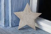 Old Rustic Christmas Star On An Old Windowsill In Blue And White.