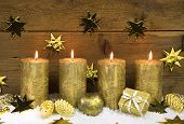 Four Golden Burning Christmas Candles For Advent Decoration.