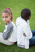 pic of not talking  - Young friends not talking to each other after fight in the park - JPG