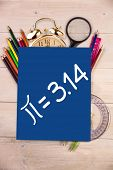Pie equation against students desk with blue page