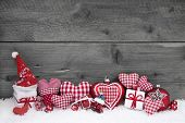 Red White Checked Christmas Decoration On Grey Wooden Background.