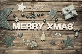 Merry Xmas: Christmas Greeting Card With Blue And White Decoration On Wood.