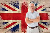 Mature student smiling against union jack flag in grunge effect