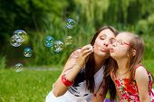 stock photo of blowing  - Family happiness and carefree concept - JPG