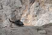 Military helicopter landed on mountain