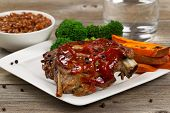 Juicy Bbq Ribs And Side Dishes With Water