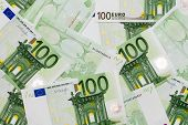 Many Of One Hundred Euro Banknotes Lie Side By Side