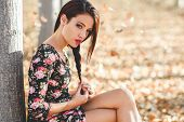 image of casual wear  - Portrait of pretty girl with green eyes wearing casual clothes in an autumn field - JPG