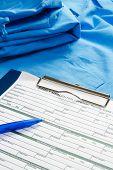 RX prescription, pen lying on a medical uniform