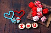 picture of love hurts  - Colourful harmony Valentine background amazing style handmade flower I love you message on wooden red color Valentine day on Feb 14 is the day for couple they give lovely gift for lover - JPG