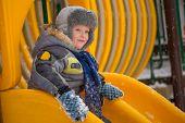Happy kids enjoying riding on sledge